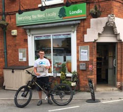 George and his bike outside paper shop