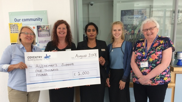 Babs Harris received cheque from Coventry staff