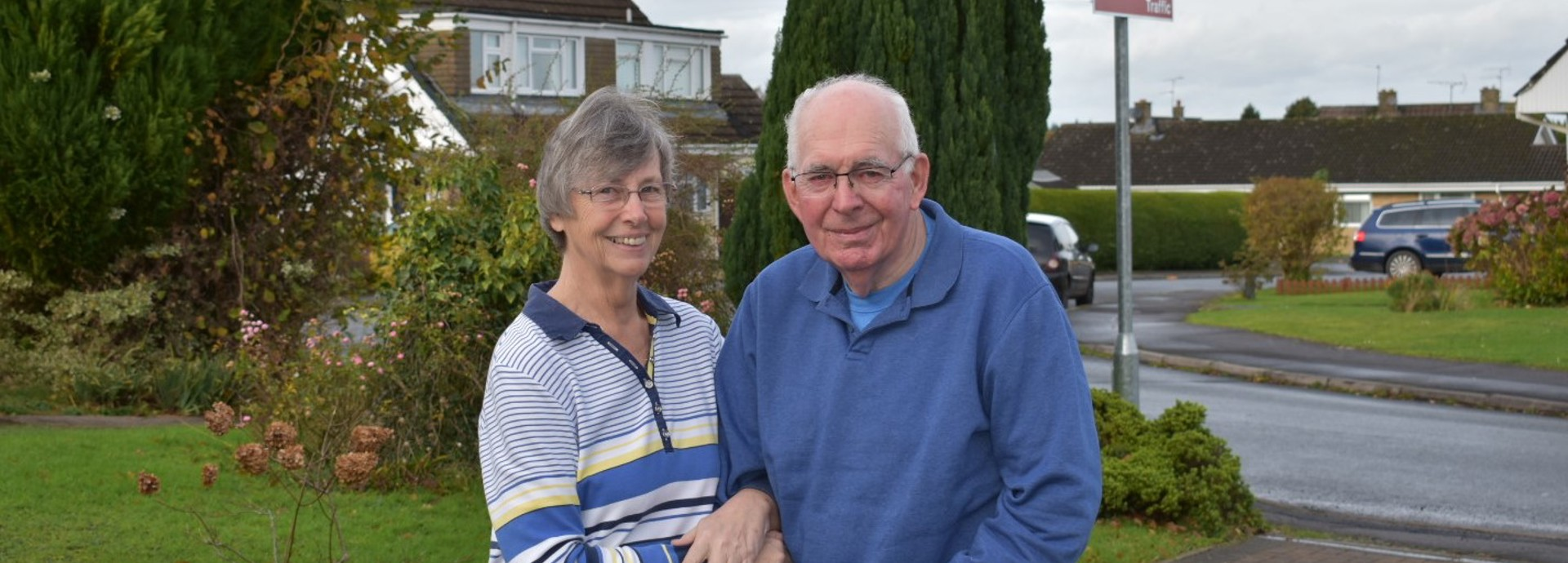 Sue and Brian Burgess outside their home