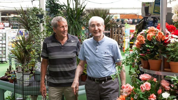 Support worker Tony and Jim strolling out  from a garden centre